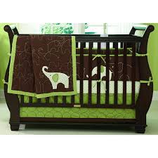 furniture green brown bedding with elephant picture placed on the black wooden crib on the