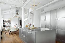 stainless steel wall cabinets kitchen situated at one end of the loft the kitchen has a