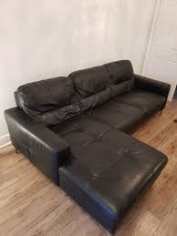 black leather sofa cuddle chair and footstool