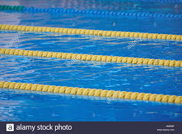 yellow lanes in blue pool water close up still pool water stock image
