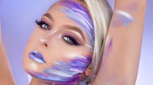 makeup artist mcdrew recreates ariana grande s body art from is a woman video