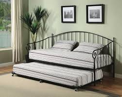 casual image of small bedroom decoration using light grey brown stripe daybed bedding including curved black iron metal pop up trundle daybed frames and