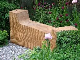 a simple wood bench is a good piece for the japanese garden
