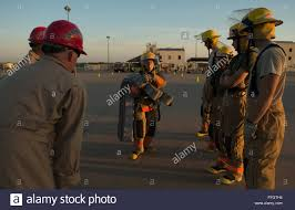 u s air force airman st class bethany parolin th training stock photo u s air force airman 1st class bethany parolin 312th training squadron goodfellow air force base texas carries a fire hose for nearly 50
