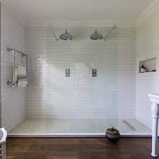 White Tiled Walk In Double Shower . Keep things ultra sleek and modern with  this frameless walk-in shower. Annabelle Holland Design has cleverly made  space ...