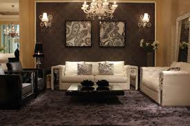interior luxury ideas of living with crystal chandelier and wall mounted lamps also paisley wall paintings and white leather sofas also paisley patterned