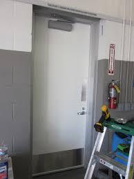 mercial steel man door with kick plates and norton door closer