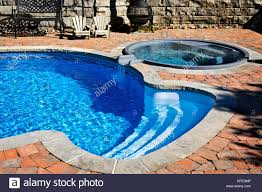 inground pools with waterfalls and hot tubs. Outdoor Inground Residential Swimming Pool In Backyard With Hot Tub - Stock Image Pools Waterfalls And Tubs