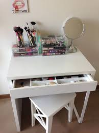 a simple makeup zone with a micke desk and a stool all the makeup in