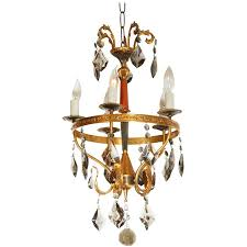 italian neoclassical style brass chandelier with smoked crystal prisms for