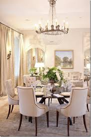 the dining table set for dinner the pair of trumeaus seen here flanking the sofa are from ahc cote de texas
