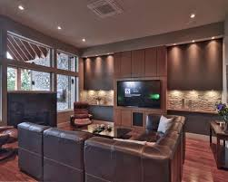 Trendy dark wood floor family room photo in Vancouver with beige walls, a  wall-