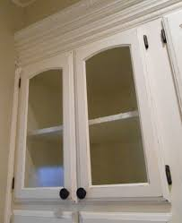 how to put glass in cabinet doors kitchen cabinet fridge glass cabinet doors painted