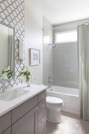 grey vanity with white interior color using elegant tiling ideas for small bathroom design plan with grey shower curtain