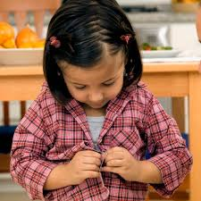 what is personal hygiene for kids com a girl tries to button her shirt up