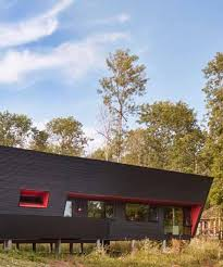 thier curran architects retirement dwelling in ontario is clad in black corrugated metal