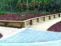building a wooden retaining wall slope garden landscaping wooden wall and stairs wood retaining ideas backyard