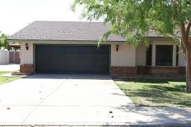 i also did not love the garage being black it always looked really dirty and i did not think it matched the house paint colors the black door always made