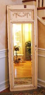 glue a floor length mirror to an old door frame love this