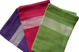 set of purple pink and green tea towels