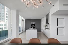 kitchen with white marble island and countertop along with stainless steel appliance photo credit
