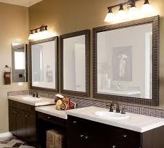 three pair of bathroom vanity mirrors in a bathroom with marble floor beige painted walls and