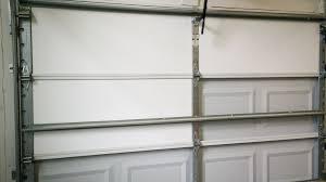 several pieces of insulation installed in a garage door