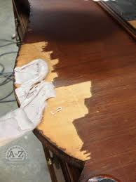 how to repair damaged wood veneer using bondo typically used for auto collision repair or 3m all purpose filler
