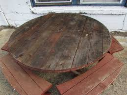 nice large round wood picnic table with 4 benches