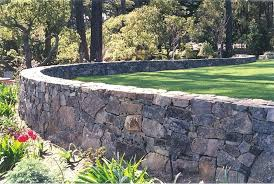 retaining walls are veneered with chief cliff stone and grey stone armour stone retaining wall ideas stone retaining wall sons masonry inc years
