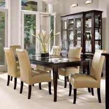 furniture design ideas of dark brown color rectangle shape wooden dining table and cream color leather armless chairs also white floor tiles and white wall