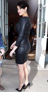 curvy in a tight leather dress