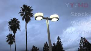 parking lot lighting w two lights design on pole lit up against gray skies hd stock footage you