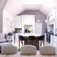 dining room flooring options uk. open-plan kitchen with grey walls, black range cooker, white cabinetry and dining room flooring options uk