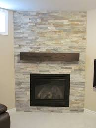 the stone and wood fireplace home design with reclaimed mantel