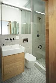 small bathroom designs ideas with clear glass doors for modern really stylish spaces florating vanity and white toilet