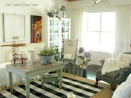 distressed wood is not out of style save your antiques and pair them with upholstered furniture for cabin inspired decor