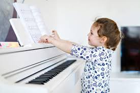 3,127 Kid Playing Piano Photos - Free & Royalty-Free Stock Photos from  Dreamstime