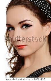 portrait of beautiful young with makeup and hairstyle inspired by sixties