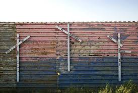 european perspective on us border build economies not fences kpbs on the mexican side of the fence crosses represent the migrants who died dur