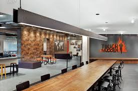 tough mudder office. tough mudder, the renowned endurance event company, partnered with vva to manage design and construction of two full floors new, open plan office mudder c