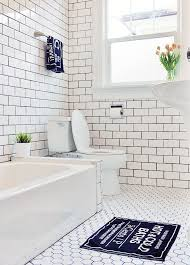 floor to ceiling subway tile bathroom. haider and her husband managed to keep a $5,000 budget while adding floor-to · white subway tile bathroomwhite floor ceiling bathroom r