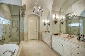 luxury master suite bathroom with elegant crystal chandelier