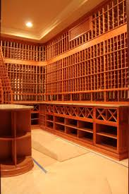 Wine racking systems constructed in Heart Redwood provided an exquisite  look to this custom wine cellar in Los Angeles California.