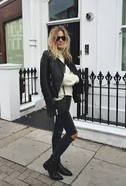 lucy williams is wearing black ripped jeans from zara white jumper from gestuz leather