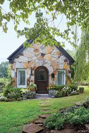 Ahh, but to live in a cottage where nature lives ~ the stone front is great.