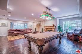 the house also has a game room inside featuring comfortable seats fireplace and a billiards
