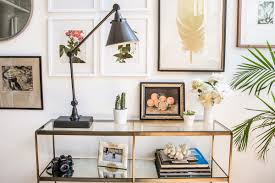 pick a statement piece of furniture as an anchor before composing your gallery around it we chose a narrow brass console that nestles nicely against the