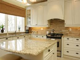 beautiful glass tile backsplash with white spring granite and floating wood cabinets plus under cabinet lighting also ceiling fan fr modern kitchen design cabinet lighting backsplash