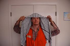 keffiyeh. fold the keffiyeh in half diagonally so you get a big triangle, then put it over your head like tim.